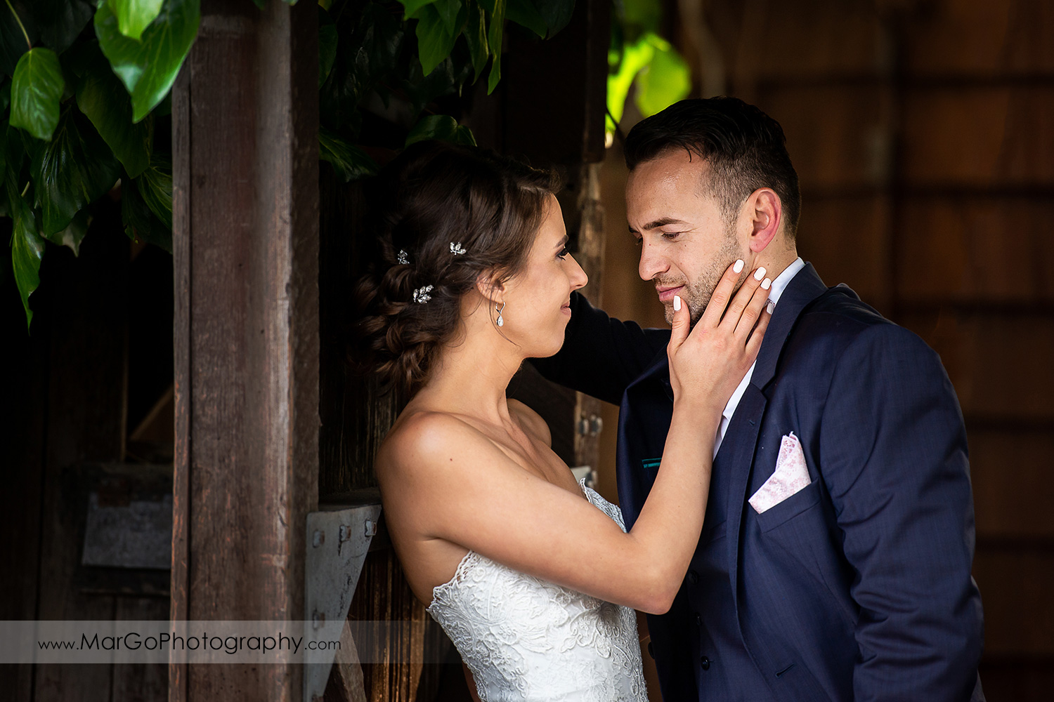 bride touching groom's face before the entrance to wedding reception at San Pablo Rockefeller Lodge