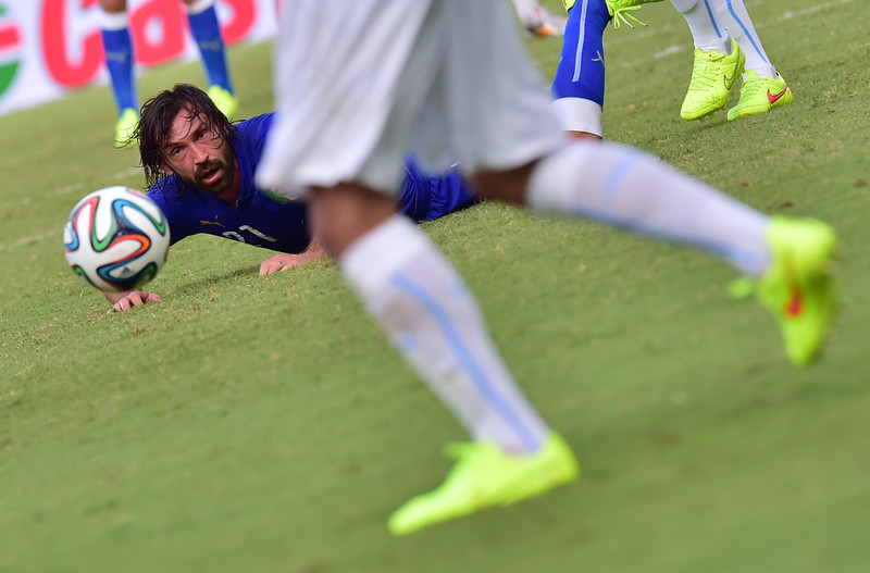 . Italy\'s midfielder Andrea Pirlo (L) falls during the Group D football match between Italy and Uruguay at the Dunas Arena in Natal during the 2014 FIFA World Cup on June 24, 2014.  (GIUSEPPE CACACE/AFP/Getty Images)