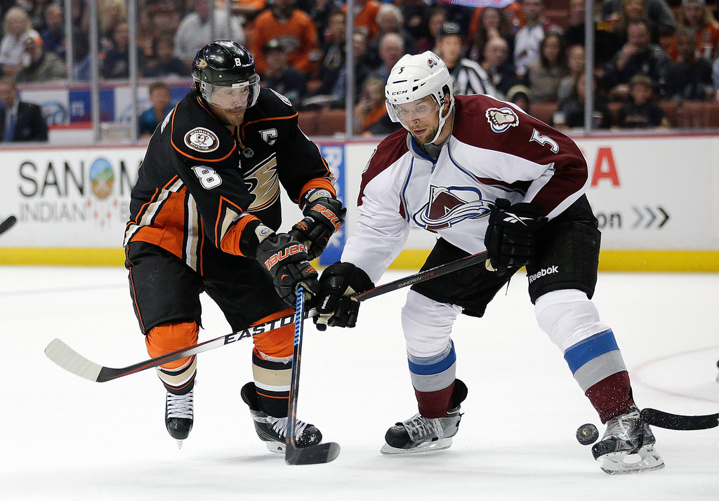 . Anaheim Ducks\' Teemu Selanne, left, of Finland, is defended by Colorado Avalanche\'s Nate Guenin during the second period of an NHL hockey game on Sunday, April 13, 2014, in Anaheim, Calif. (AP Photo/Jae C. Hong)