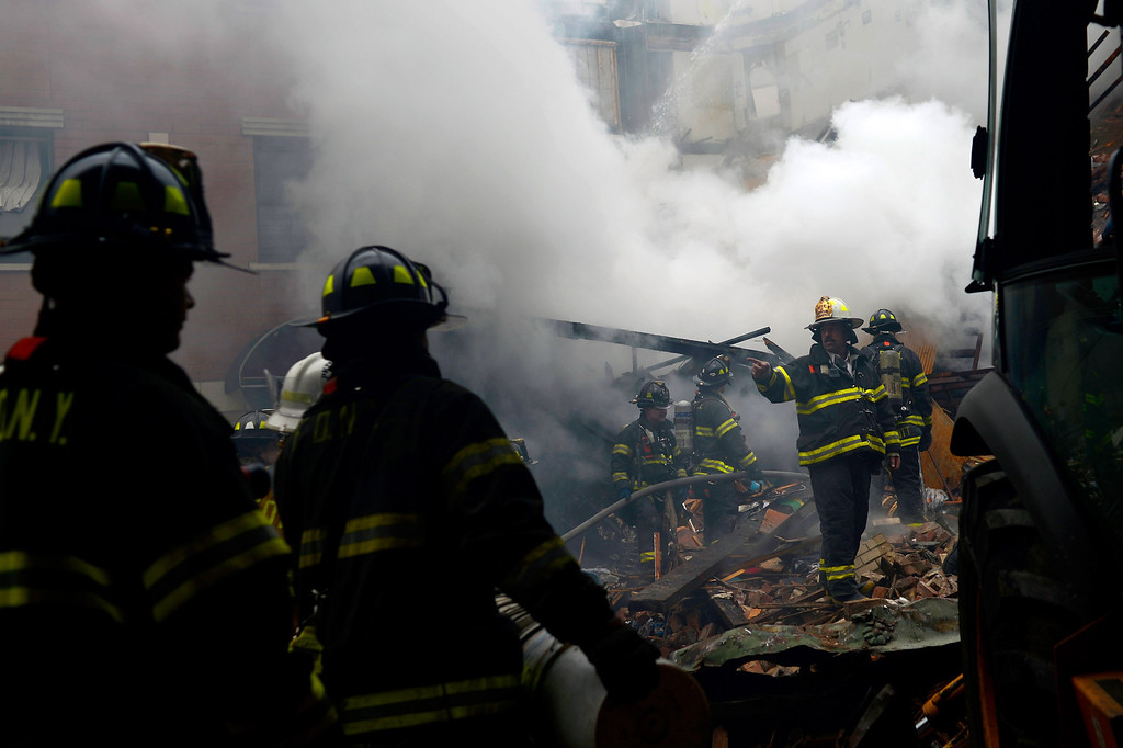 . In this image handout provided by the Office of Mayor of New York, firefighters from the Fire Department of New York (FDNY) respond to a five-alarm fire and building collapse at 1646 Park Ave in the Harlem neighborhood of Manhattan March 12, 2014 in New York City. (Photo by Rob Bennett/Office of Mayor of New York/Getty Images)