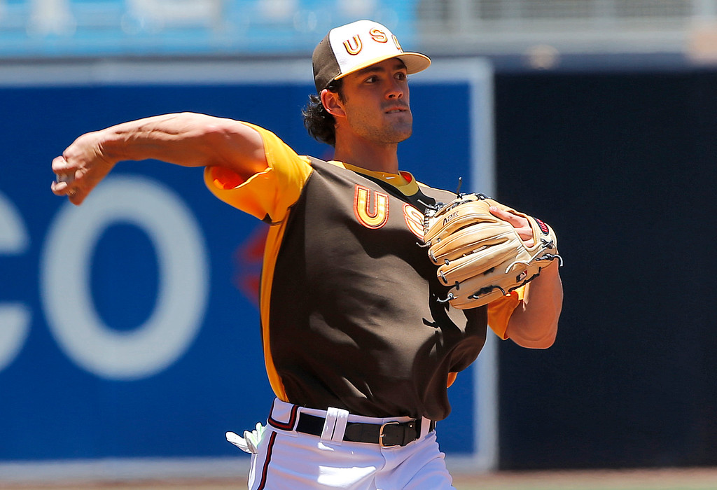 . U.S team\'s Dansby Swanson, of the Atlanta Braves, warms up prior to the All-Star Futures baseball game against the World team, Sunday, July 10, 2016, in San Diego. (AP Photo/Lenny Ignelzi)