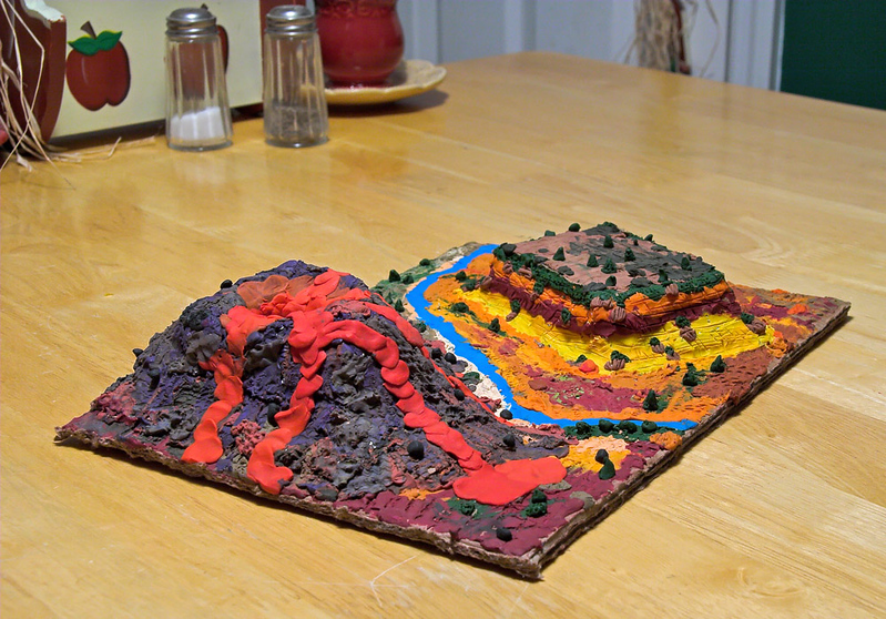 Landscape by Joshua and Dad, October 2005. The 3D shapes were built by layering cardboard, then covering with crinkled tinfoil.  I wish I had taken pictures as we went.