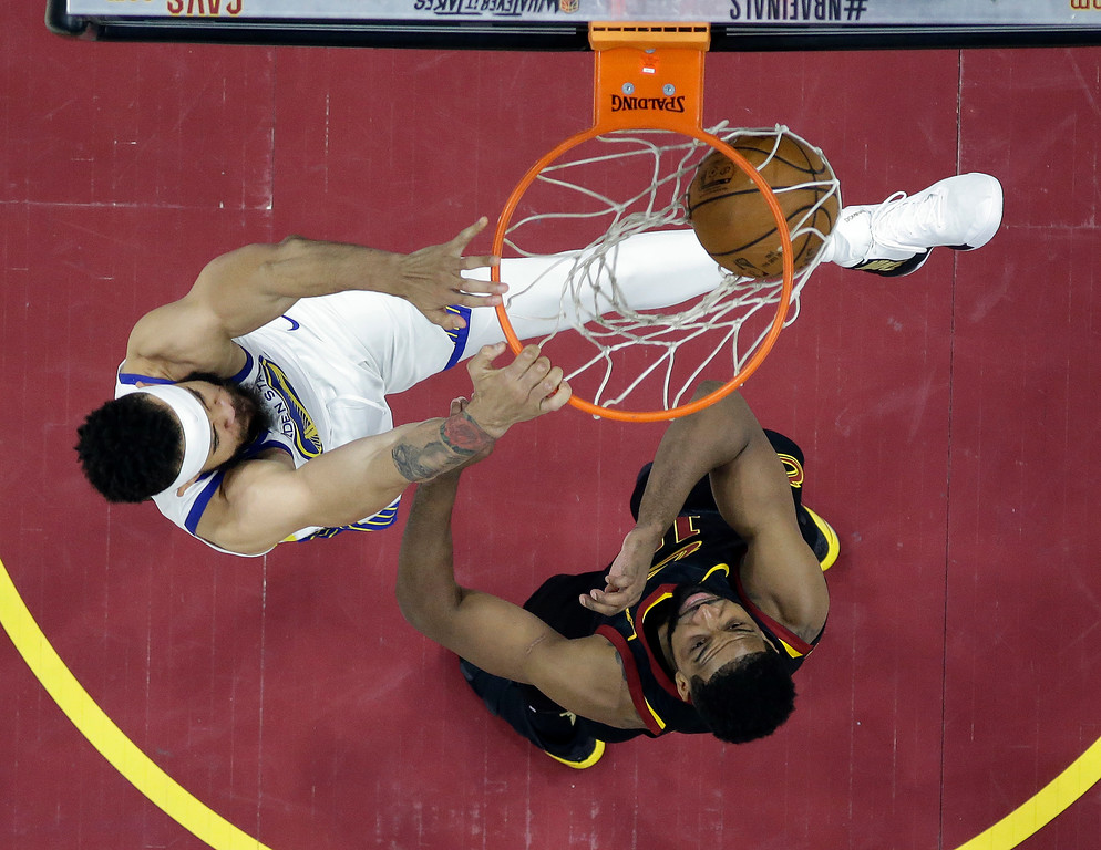 . Golden State Warriors center JaVale McGee dunks over Cleveland Cavaliers center Tristan Thompson, right, during the second half of Game 3 of basketball\'s NBA Finals, Wednesday, June 6, 2018, in Cleveland. (AP Photo/Carlos Osorio, Pool)