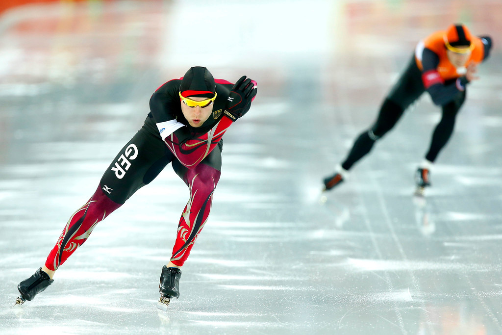 . Nico Ihle of Germany (L) competes Stefan Groothuis of the Netherlands  during the Men\'s 1000m Speed Skating event with coach coach Jac Orie in the Adler Arena at the Sochi 2014 Olympic Games, Sochi, Russia, on February 12, 2014.  EPA/VINCENT JANNINK
