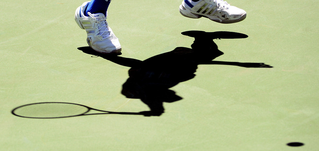 . University\'s (Irvine) Garrett Kurtz returns a shot by San Marino doubles team Robert Carter and Charles Deng (not pictured) during the CIF State Tennis Championship at the Claremont Club in Claremont, Calif., on Saturday, May 31, 2014.  (Keith Birmingham/Pasadena Star-News)
