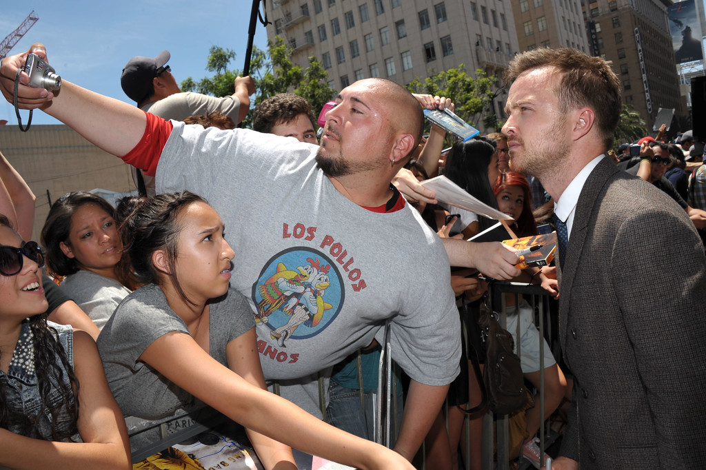 . Aaron Paul signs autographs at Bryan Cranston\'s  star ceremony on the Hollywood Walk of Fame on Tuesday, July 16, 2013 in Los Angeles. (Photo by John Shearer/Invision for AMC/AP Images)
