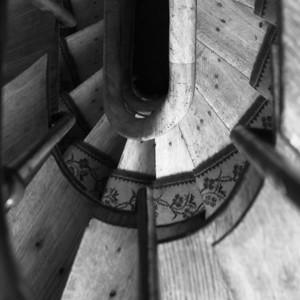 Circular stairway in old apartment building, Paris 11eme
