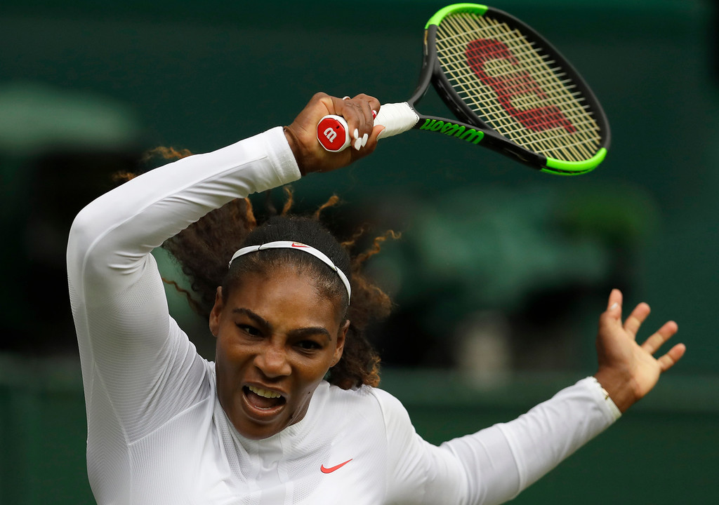 . Serena Williams of the United States returns the ball to Bulgaria\'s Viktoriya Tomova during their women\'s singles match, on the third day of the Wimbledon Tennis Championships in London, Wednesday July 4, 2018. (AP Photo/Kirsty Wigglesworth)