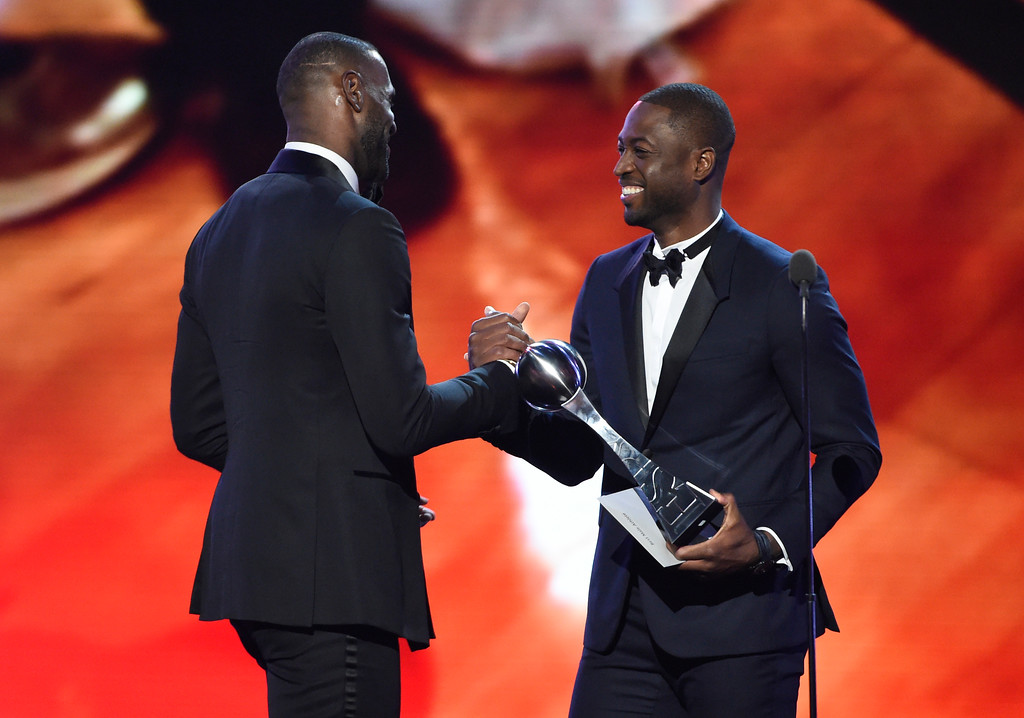 . Dwyane Wade, right, presents the award for best male athlete to LeBron James, of the Cleveland Cavaliers, at the ESPY Awards at the Microsoft Theater on Wednesday, July 13, 2016, in Los Angeles. (Photo by Chris Pizzello/Invision/AP)