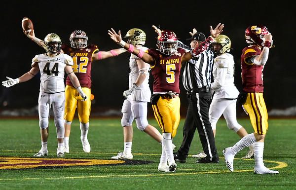 12/14/2019 Mike Orazzi | Staff St. Joseph High School's Davee Silas (5) celebrates a 17-13 win over Daniel Hand at Veteran's Stadium in New Britain on Saturday.