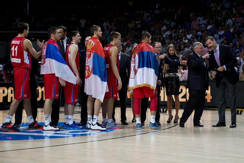 . Fiba president Ivan Mainini (2ndR) inidcates Prince Felipe VI of Spain (R) as Sebia players receive their medalls during the award ceremony after the 2014 FIBA World Basketball Championship final match between USA and Serbia at Palacio de los Deportes on September 14, 2014 in Madrid, Spain. (Photo by Gonzalo Arroyo Moreno/Getty Images)