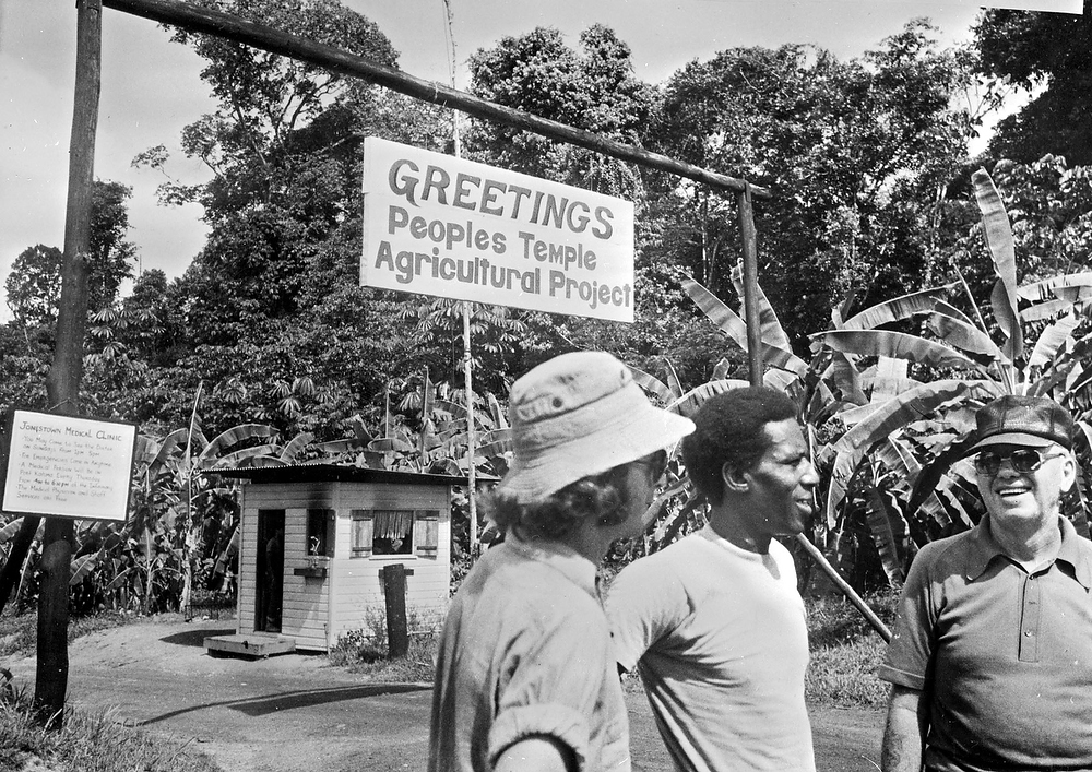 ". Members of the cult  ""Peoples Temple\""  in front of the agricultural department of the sect, in Georgetown, renamed Jonestown, Jim Jones guru\'s name. Bodies of more than 900 members of the sect were discovered after they committed  mass suicide in compliance with the rules of the sect on November 20, 1978. (Photo by AFP/Getty Images)"