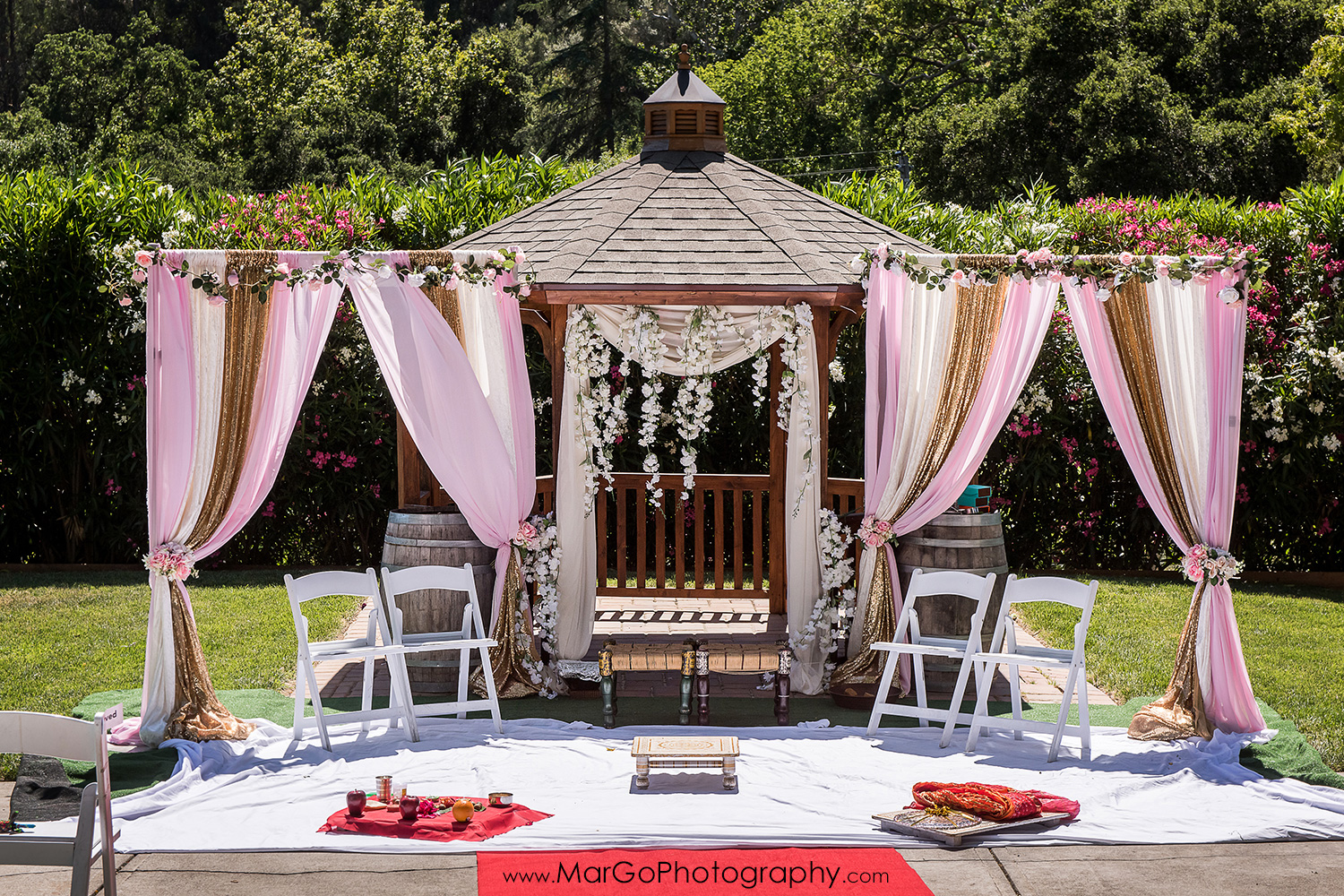 white, pink and golden mandap for Indian wedding ceremony at Elliston Vineyards in Sunol