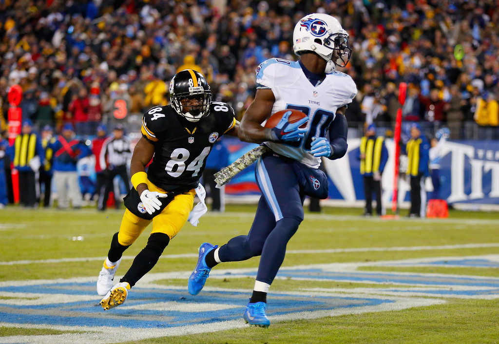 . NASHVILLE, TN - NOVEMBER 17:   Bishop Sankey #20 of the Tennessee Titans incercepts a pass in the endzone against  Antonio Brown #84 of the Pittsburgh Steelers during the second quarter of the game at LP Field on November 17, 2014 in Nashville, Tennessee.  (Photo by Wesley Hitt/Getty Images)