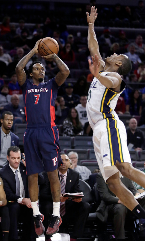 . Detroit Pistons\' Brandon Jennings (7) takes a shot against Utah Jazz\'s Alec Burks during the second half of an NBA basketball game, Sunday, Nov. 9, 2014, in Auburn Hills, Mich. Jennings led the Pistons with 23 points. The Jazz defeated the Pistons 97-96. (AP Photo/Duane Burleson)