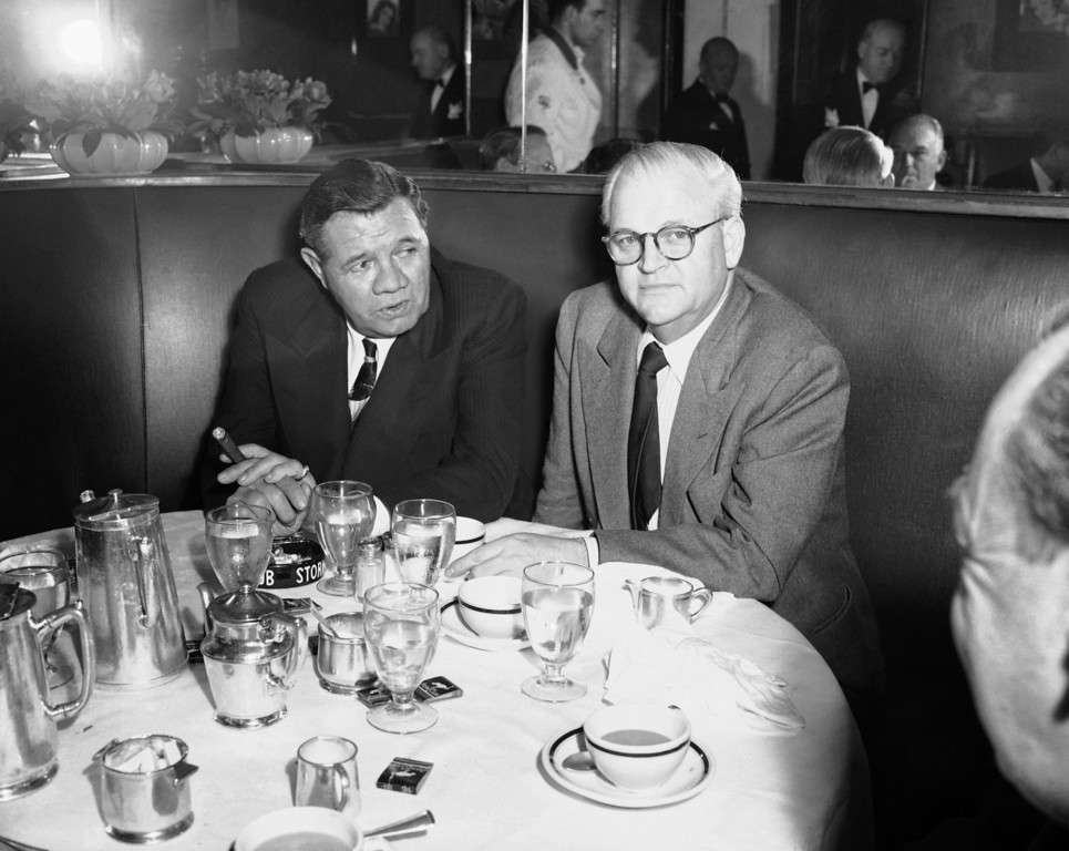 ". Babe Ruth,  left, the most colorful baseball player of all time, confers with Allied Artists producer Roy Del Ruth who is producing ""The Life of Babe Ruth,\"" Nov. 1947, in the Stork Club in New York. Del Ruth is currently searching for an actor to play the role of the great Bambino.  (AP Photo)"