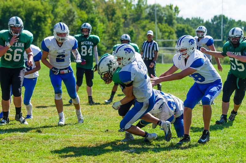 Josh Brazeau drags a few defenders with him and drives McCann down to the goal line in the fourth quarter.
