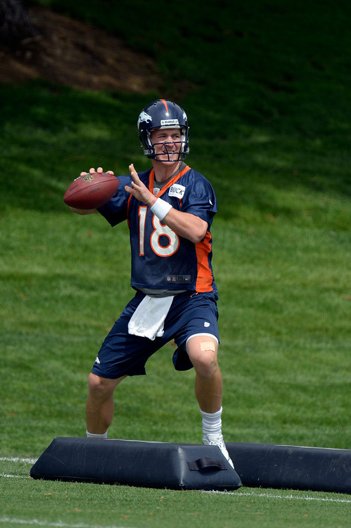 . Peyton Manning (18) of the Denver Broncos works on drills during mini camp June 12, 2013 at Dove Valley. (Photo By John Leyba/The Denver Post)
