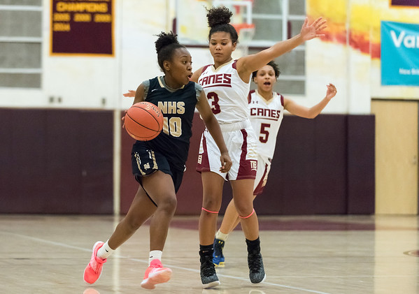 12/10/18 Wesley Bunnell | Staff New Britain girls basketball was defeated 52-39 at home against Newington on Thursday evening. Ashanti Frazier (10). is guarded by Maya Slisz (3).