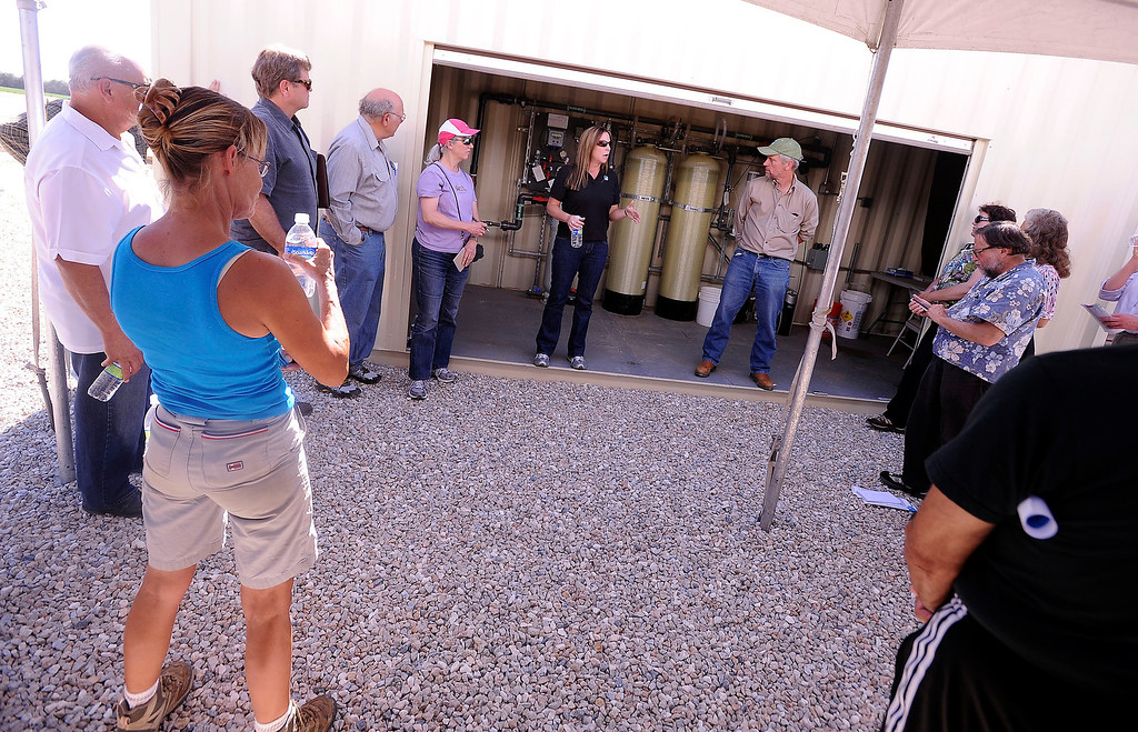 . Members of the Lahontan Regional Water Quality Control Board and members of the community take a PG&E tour to learn more about a Whole House Water system at an agriculture unit in Hinkley June 13, 2012.  GABRIEL LUIS ACOSTA/STAFF PHOTOGRAPHER.