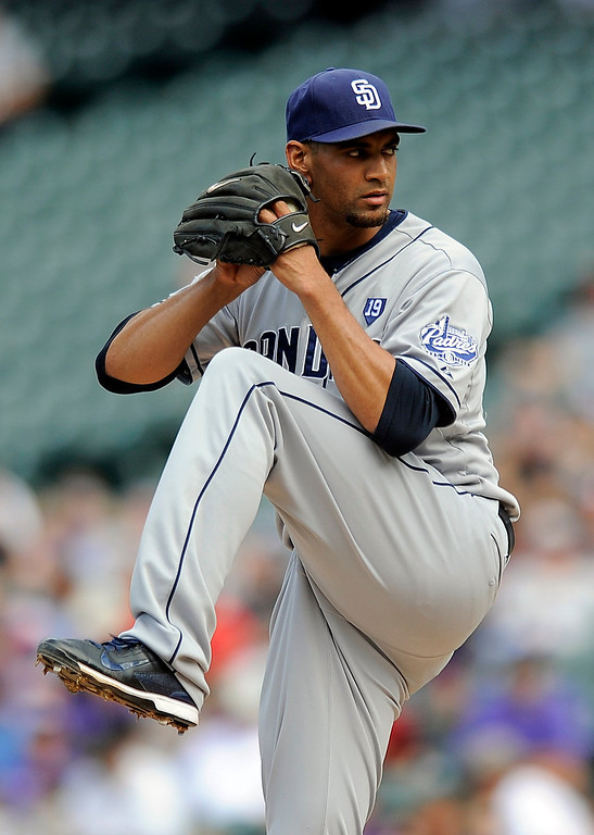 . San Diego Padres starting pitcher Tyson Ross throws in the first inning of a baseball game against the Colorado Rockies, Sunday, Sept. 7, 2014, in Denver. (AP Photo/Chris Schneider)