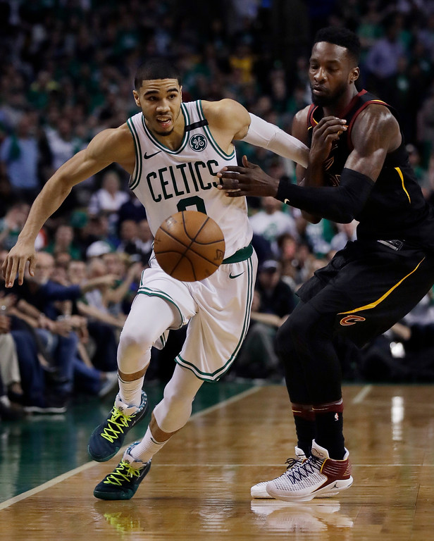 . Boston Celtics forward Jayson Tatum (0) dribbles downcourt against pressure from Cleveland Cavaliers forward Jeff Green during the fourth quarter of Game 5 of the NBA basketball Eastern Conference finals Wednesday, May 23, 2018, in Boston. (AP Photo/Charles Krupa)