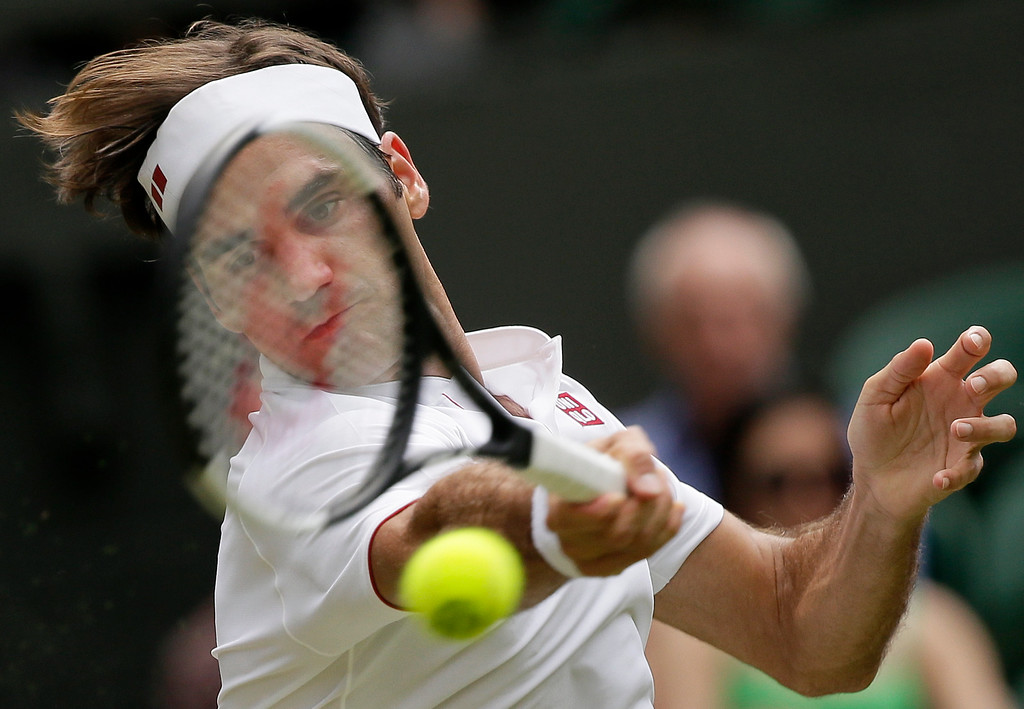 . Roger Federer of Switzerland returns the ball to France\'s Adrian Mannarino during their men\'s singles match, on day seven of the Wimbledon Tennis Championships, in London, Monday July 9, 2018. (AP Photo/Tim Ireland)