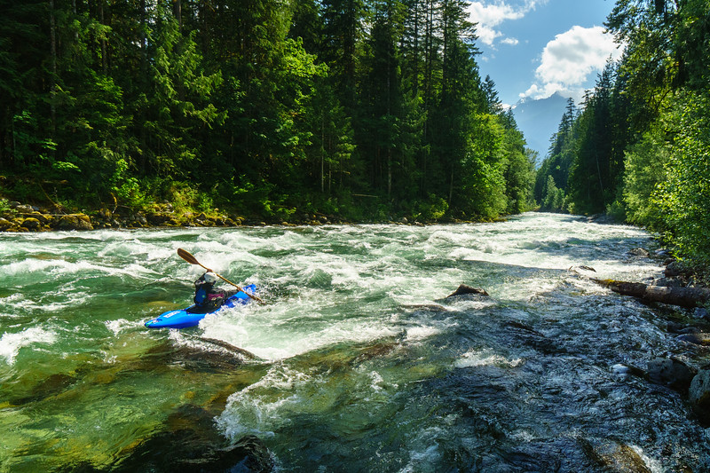 Daphnee Tuzlak enjoys the clear blue water and mountain scenery of the Chilliwack in southern British Columbia.