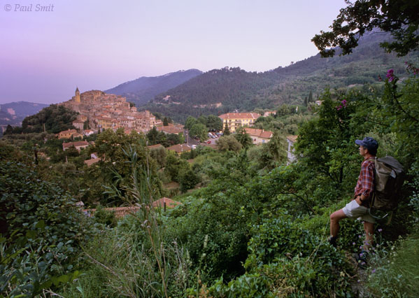 [FRANCE.COTEDAZUR 2715]  'Gorbio.'  Hiker overlooking the perched village of Gorbio in the hinterland of Menton, just after sunset. Photo Paul Smit.