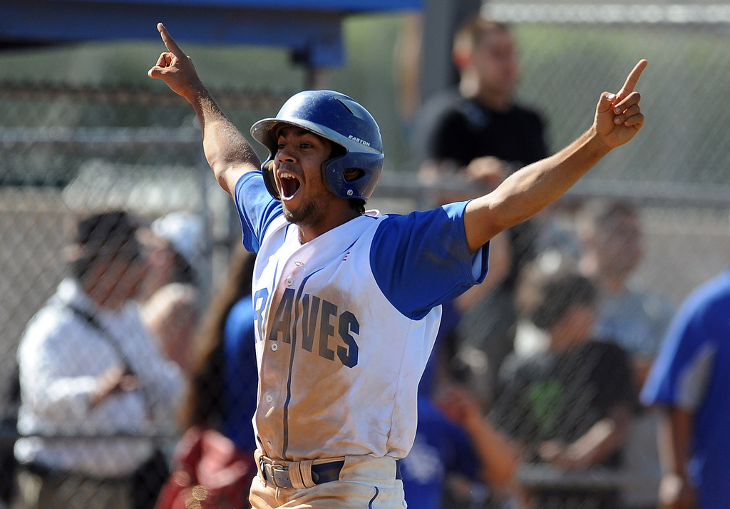 . Baldwin Park\'s Robert Velasquez reacts after Jesus Rojo (not pictured) hits a three run home run in the fifth inning of a CIF-SS semifinal prep playoff baseball game against El Rancho at Baldwin Park High School on Tuesday, May 28, 2013 in Baldwin Park, Calif.  El Rancho won 5-4.  (Keith Birmingham/Pasadena Star-News)