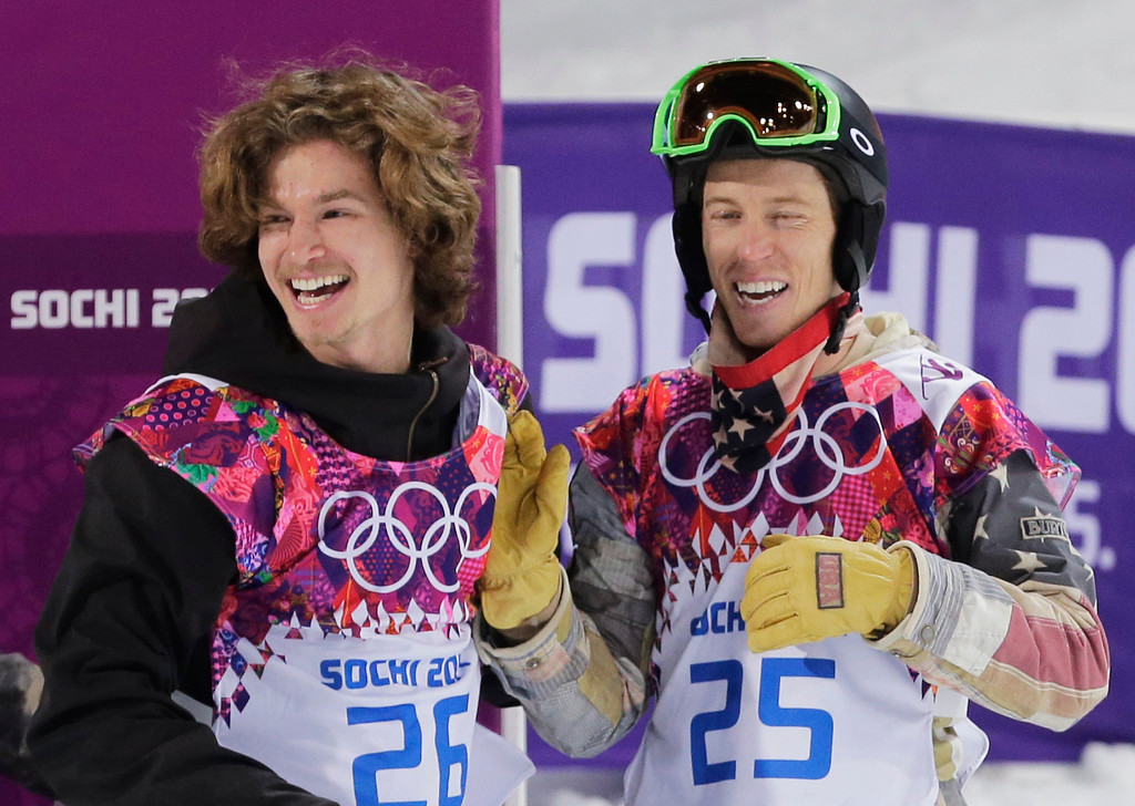 . Switzerland\'s Iouri Podladtchikov, left, celebrates with Shaun White of the United States after  Podladtchikov won the gold medal in the men\'s snowboard halfpipe final at the Rosa Khutor Extreme Park, at the 2014 Winter Olympics, Tuesday, Feb. 11, 2014, in Krasnaya Polyana, Russia. (AP Photo/Andy Wong)