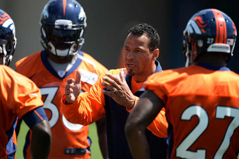 . Denver Broncos Minority Coaching Intern Rod Woodson talks to the safeties during OTAs June 12, 2014 at Dove Valley. (Photo by John Leyba/The Denver Post)