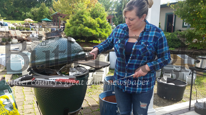 Shelley Venesky of Summit Township grills up some samples at the Allgreen Eggfest in Middlesex Township on Saturday. All proceeds from the event benefited South Butler Community Meals on Wheels.