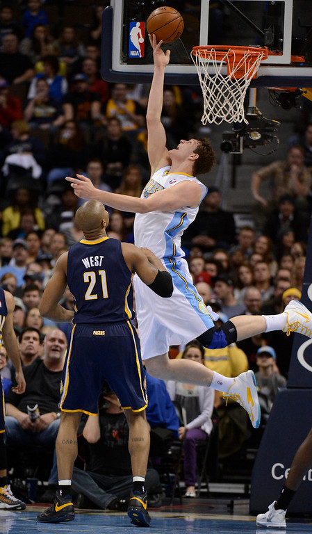 . DENVER, CO. - JANUARY 28: Denver Nuggets center Timofey Mozgov (25) goes up for a reverse layup past Indiana Pacers power forward David West (21) during the second quarter January 28, 2013 at Pepsi Center. The Denver Nuggets host  the Indiana Pacers in NBA Action. (Photo By John Leyba / The Denver Post)