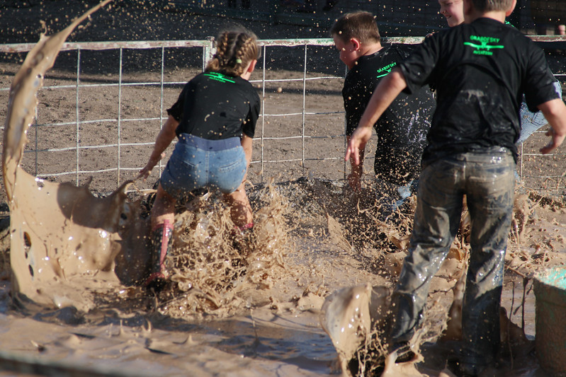 Havre Daily News / Floyd Brandt  Pig Wrestling at Blain County Fair Sunday team Muddie Buddies