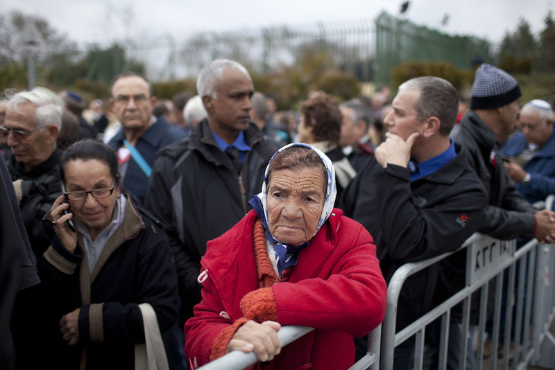 . An Israeli woman stands in line as she waits to pay her last respects to Ariel Sharon out side the Knesset (Israeli Parliament), where his body is lying in state on January 12, 2014 in Jerusalem, Israel.(Photo by Lior Mizrahi/Getty Images)