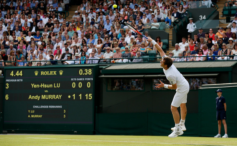 . Britain\'s Andy Murray serves to Lu Yen-Hsun of Taiwan during their Men\'s second round singles match at the All England Lawn Tennis Championships in Wimbledon, London,  Wednesday, June 26, 2013. (AP Photo/Sang Tan)