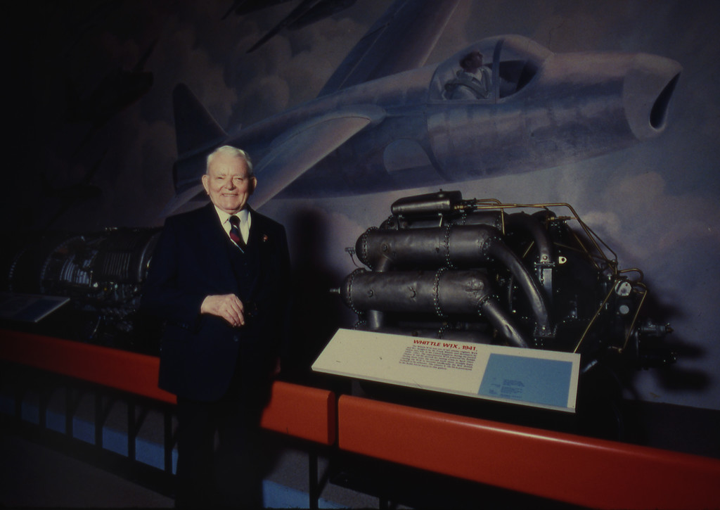 . Jet engine inventor Sir Frank Whittle, inventor of the first British turbine jet engine to power aircrafts, stands next a prototype on display at the Smithonian Air and Space Museum, Wednesday April 8, 1996, in Washington, USA. The museum is celebrating its 50th anniversary. (AP Photo/Martin Simon)