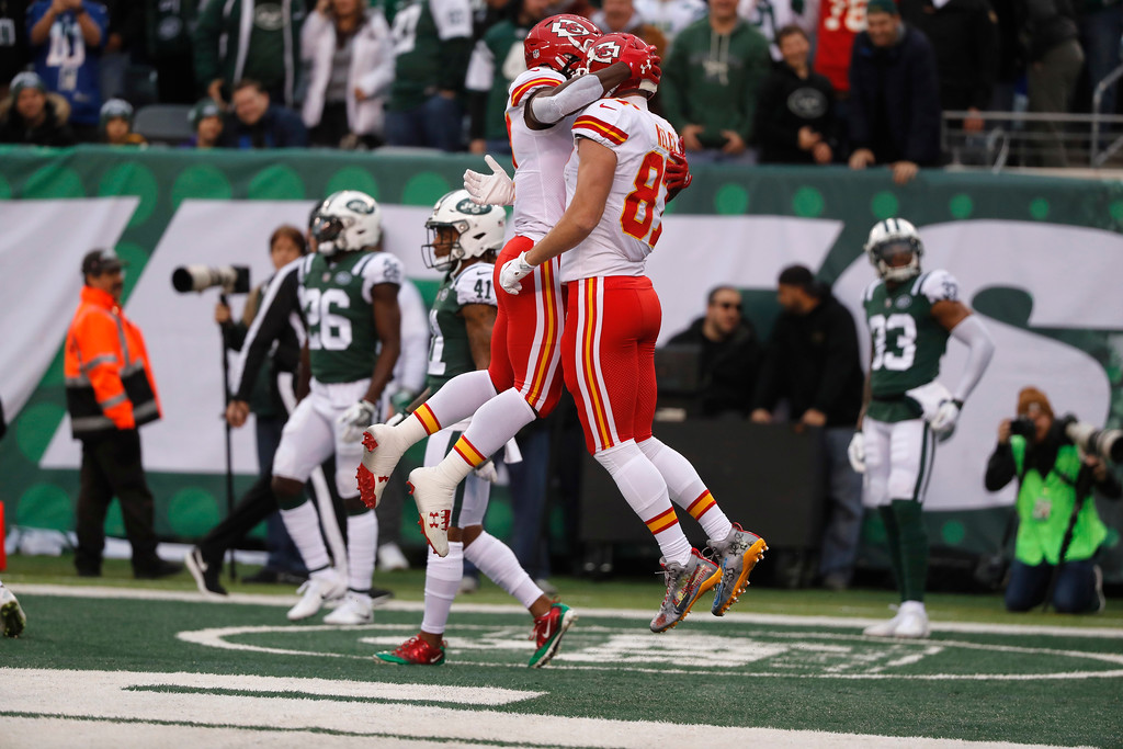 . Kansas City Chiefs\' Travis Kelce, right, celebrates his touchdown with Kareem Hunt during the first half of an NFL football game, Sunday, Dec. 3, 2017, in East Rutherford, N.J. (AP Photo/Julie Jacobson)