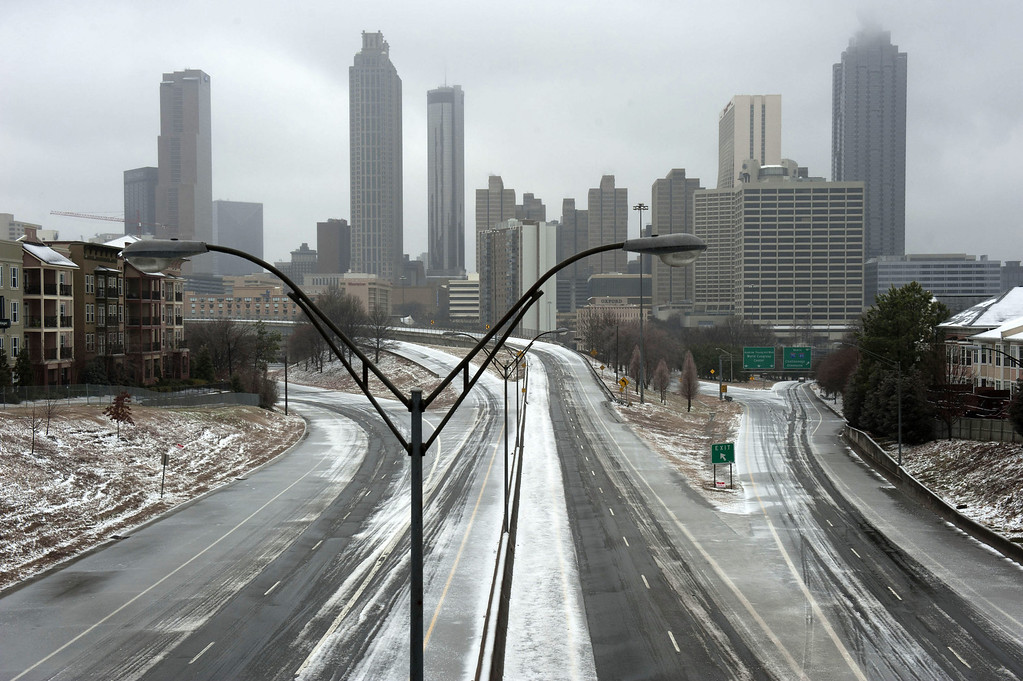 . A normally busy Freedom Parkway sits empty in front of the Atlanta skyline on February 12, 2014 in Atlanta, Georgia. Public schools were closed for another day, and hazardous road conditions kept most people home. A state of emergency was declared in 45 Georgia counties as sleet, freezing rain and snow fell across the state. (Photo by Davis Turner/Getty Images)