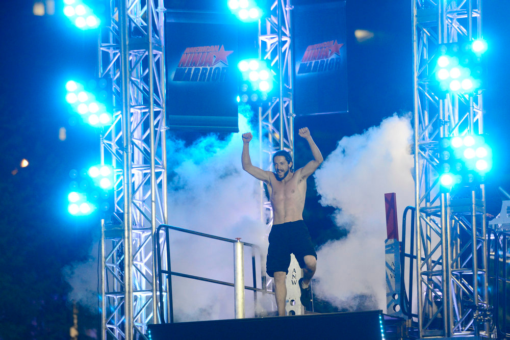 . Isaac Caldiero (dressed as Jesus Christ) celebrates during his tryout for American Ninja Warrior Denver. Caldiero dominated the course. (Photo by AAron Ontiveroz/The Denver Post)
