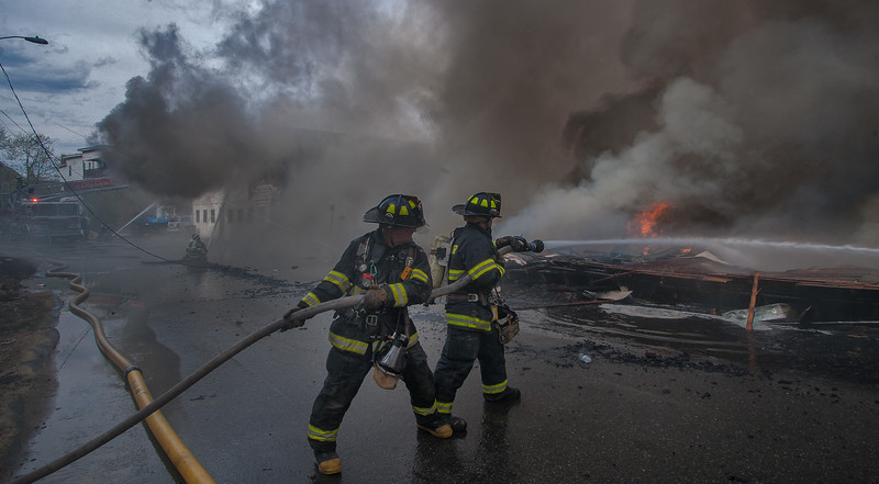 Gardner FFs operate a hand line on the remnants of a vacant factory on Sherman St.
