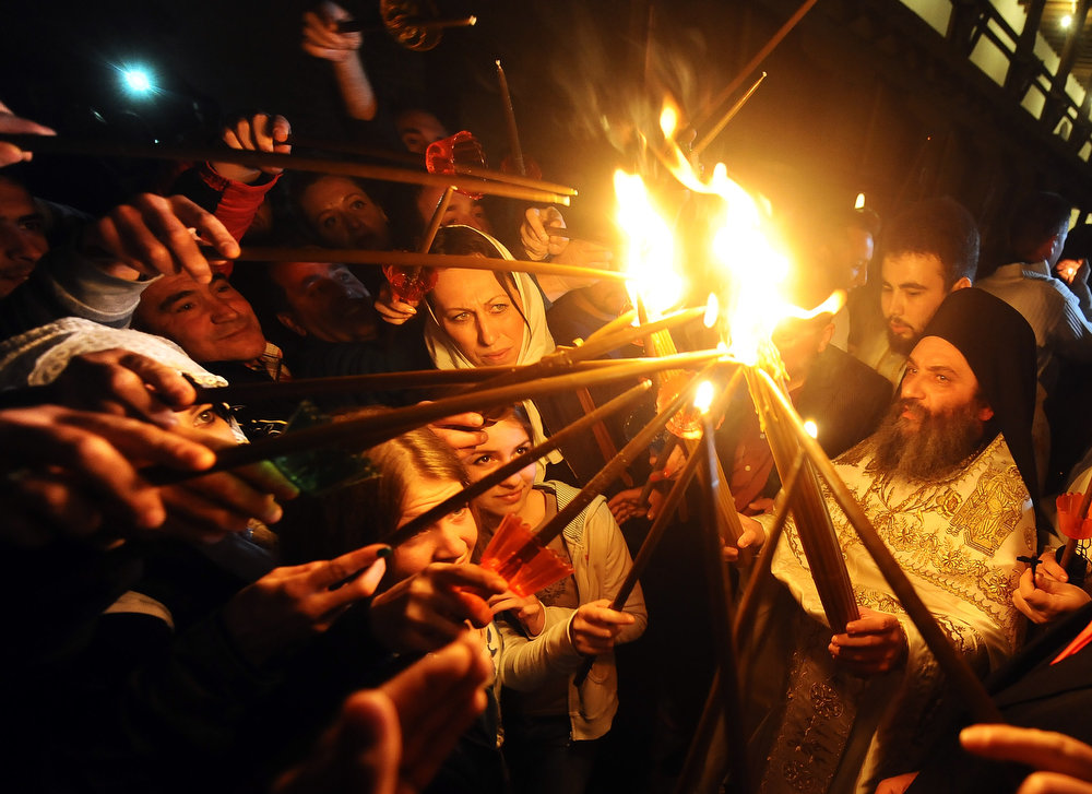 . Macedonian Orthodox light up their candles from the holy fire that arrived from Jerusalem during the Easter service at the Saint-Jovan Bigorski monastery some 145 km west from the capital Skopje, early on May 5, 2013. The Macedonian Orthodox Church celebrated Easter, according to the Julian calendar.   ROBERT ATANASOVSKI/AFP/Getty Images