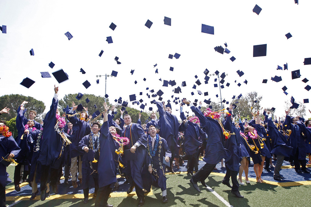 . The Notre Dame High School graduation class toss their caps in the air at the completion of the graduation ceremony on Saturday, June 01, 2013 in Sherman Oaks, CA.  Photo by Michael Yanow