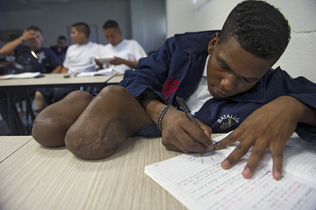 . Colombian soldier Aldemar Benitez, 23, writes notes during his rehabilitation therapy session at the Heroes de Paramillo hospital  in Medellin, Antioquia department, Colombia on September 11, 2013.   RAUL ARBOLEDA/AFP/Getty Images