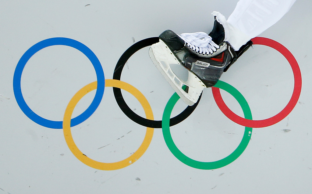. Slovakia defenseman Martin Marincin climbs onto the ice in the first period of a men\'s ice hockey game against Slovenia at the 2014 Winter Olympics, Saturday, Feb. 15, 2014, in Sochi, Russia. (AP Photo/Julio Cortez)
