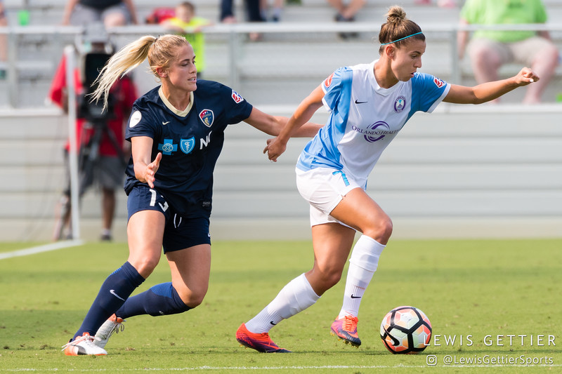 Steph Catley (7) and Abby Dahlkemper (13) during a match between the NC Courage and the Orlando Pride in Cary, NC in Week 3 of the 2017 NWSL season. Photo by Lewis Gettier.