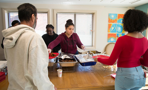 12/20/19 Wesley Bunnell | StaffrrHigh School Senior Jayanna Rodriguez serves holiday meals at Howey House on Monday afternoon as part of her Capstone Project along with three other seniors. Howey House is a part of shelter for chronically homeless persons.