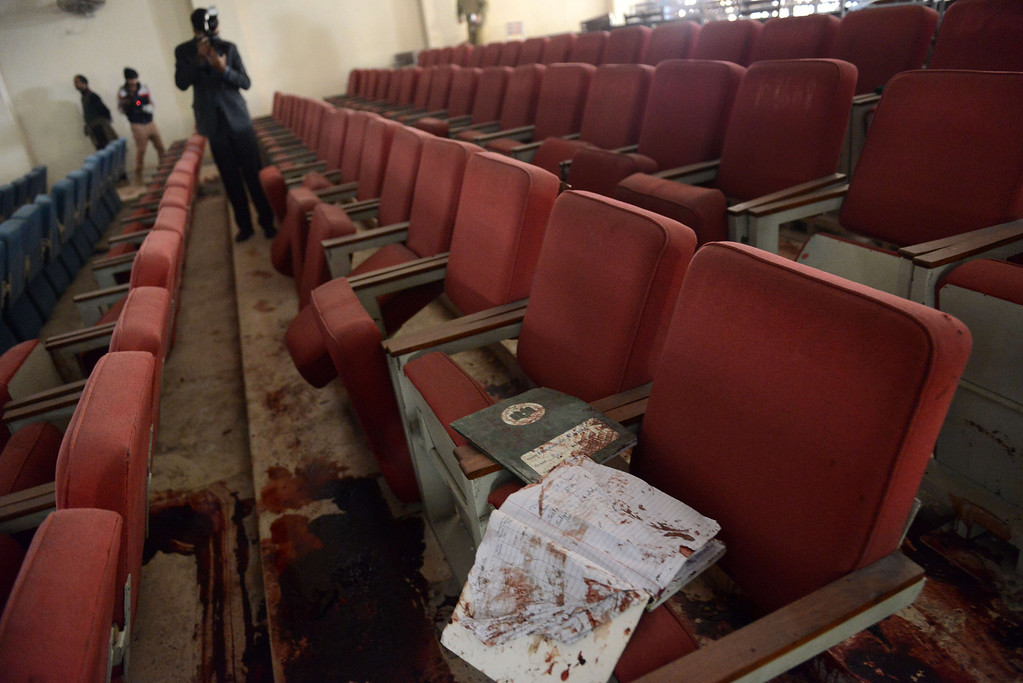 . A Pakistani photographer takes photographs of a bloodied ceremony hall at an army-run school a day after an attack by Taliban militants in Peshawar on December 17, 2014.  Pakistan began three days of mourning on December 17 for the 132 schoolchildren and nine staff killed by the Taliban in the country\'s deadliest ever terror attack as the world united in a chorus of revulsion.  AFP PHOTO / A  Majeed/AFP/Getty Images
