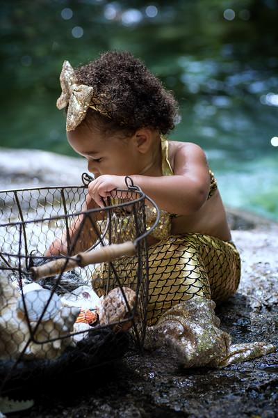 Alina7.19.18 sitting sin basket.jpg
